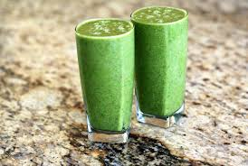 green smoothie with berries and green leafy veggies